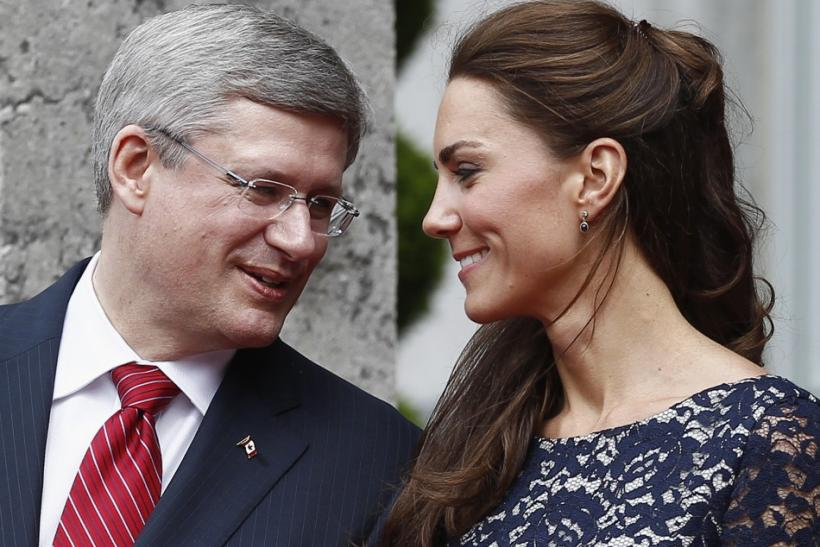 Catherine, Duchess of Cambridge, speaks with Canada's Prime Minister Stephen Harper during an official welcoming ceremony at Rideau Hall in Ottawa
