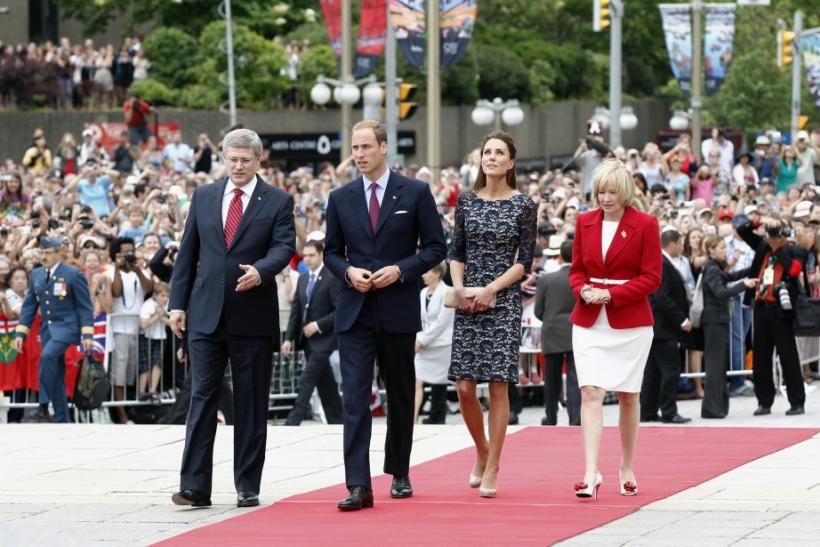 Canada's Prime Minister Harper and his wife Laureen arrive alongside Britain's Prince William and his wife Catherine, Duchess of Cambridge at the National War Memorial in Ottawa