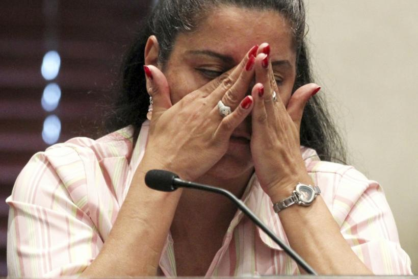 Holloway reacts while testifying during Anthony murder trial at the Orange County Courthouse in Orlando