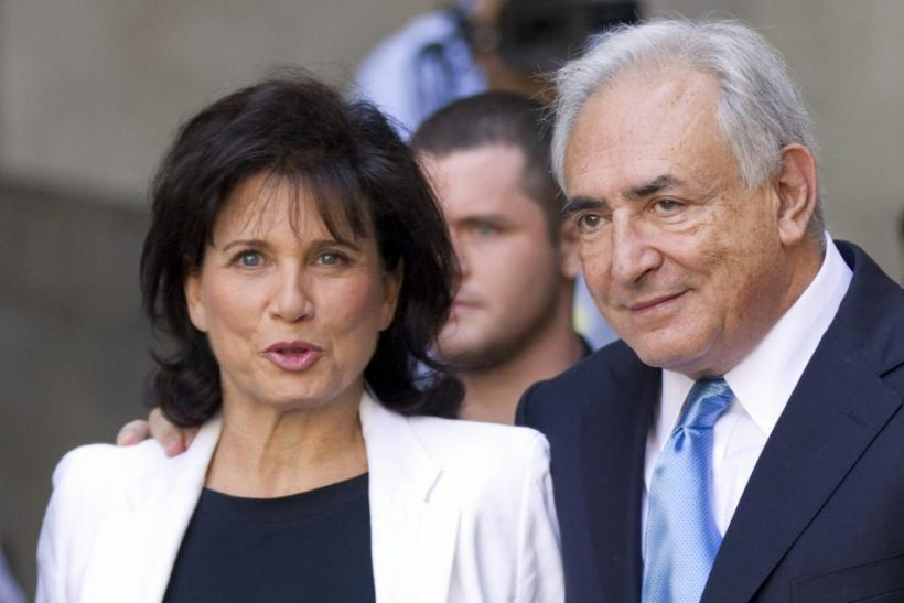 Dominique Strauss-Kahn and his wife Anne Sinclair depart a hearing at the New York State Supreme Courthouse in New York