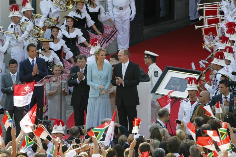 Newlyweds Prince Albert II of Monaco and Princess Charlene applaud on the Palace square after their civil wedding service in Monaco