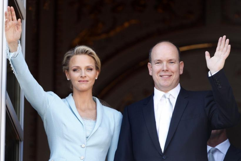 Newlyweds Prince Albert II of Monaco and Princess Charlene wave on the Palace balcony after the civil wedding service in Monaco