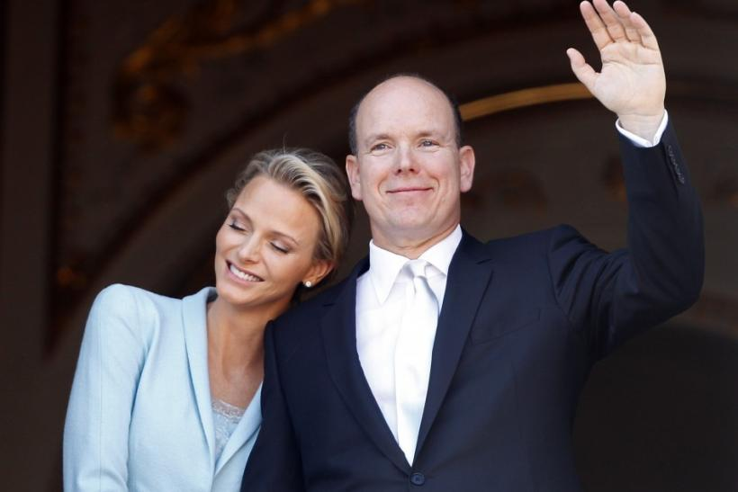 Newlyweds Prince Albert II of Monaco waves as Princess Charlene rests her head on his shoulder on the Palace balcony after the civil wedding service in Monaco