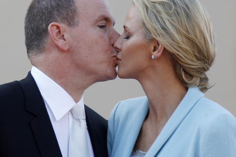 Newlyweds Prince Albert II of Monaco and Princess Charlene kiss on the Palace square after the civil wedding service in Monaco