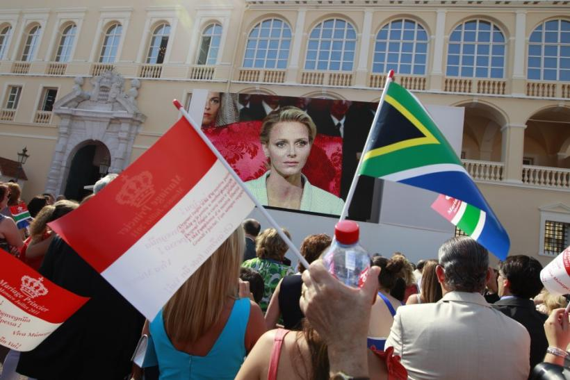 Citizens of Monaco react as they watch a giant screen in the Palace square as Monaco's Prince Albert II and Princess Charlene are married in a civil wedding service in Monaco