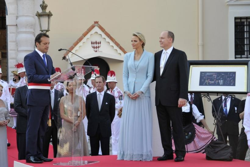 The Mayor of Monaco Georges Marsen speaks to the Prince Albert II of Monaco and Princess Charlene as they receive presents from the Monegasques