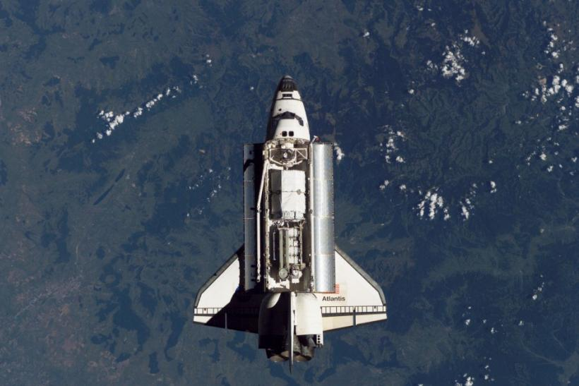 NASA handout photo of Atlantis near the ISS