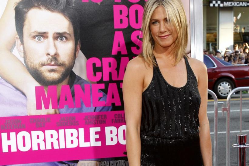 "Aniston poses at the premiere of ""Horrible Bosses"" at the Grauman's Chinese theatre in Hollywood"