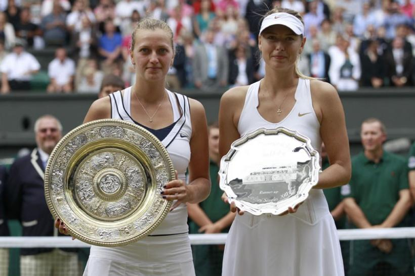 Kvitova and Sharapova with their Wimbledon Trophies