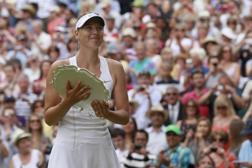 Maria Sharapova of Russia holds her Wimbledon runners-up trophy