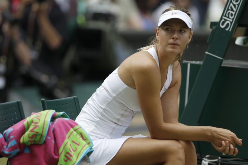 Maria Sharapova of Russia watches the presentation to Petra Kvitova of the Czech Republic after being defeated by her in the women's singles final match at the Wimbledon tennis championships in London
