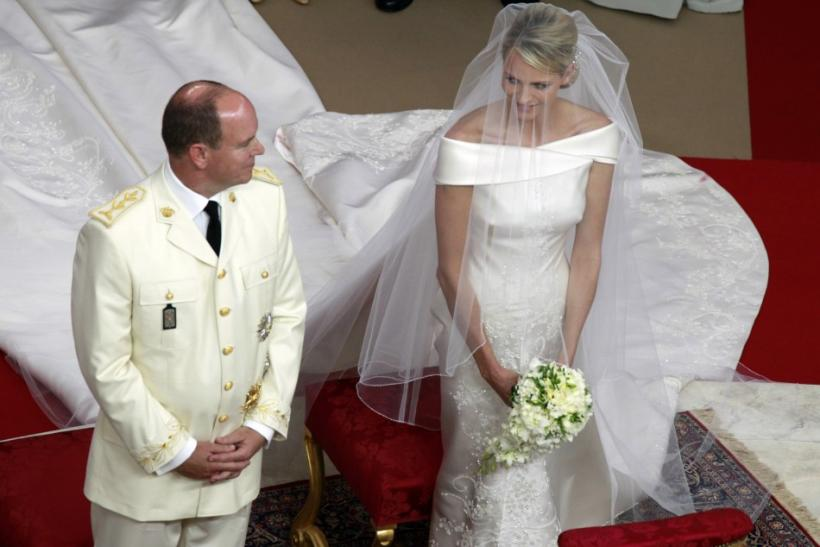 Monaco's Prince Albert II and Princess Charlene exchange glances during their religious wedding ceremony at the Palace in Monaco