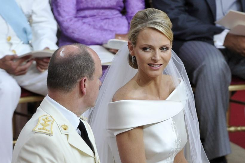 Princess Charlene smiles at her husband Prince Albert II of Monaco during their religious wedding ceremony at the Palace in Monaco