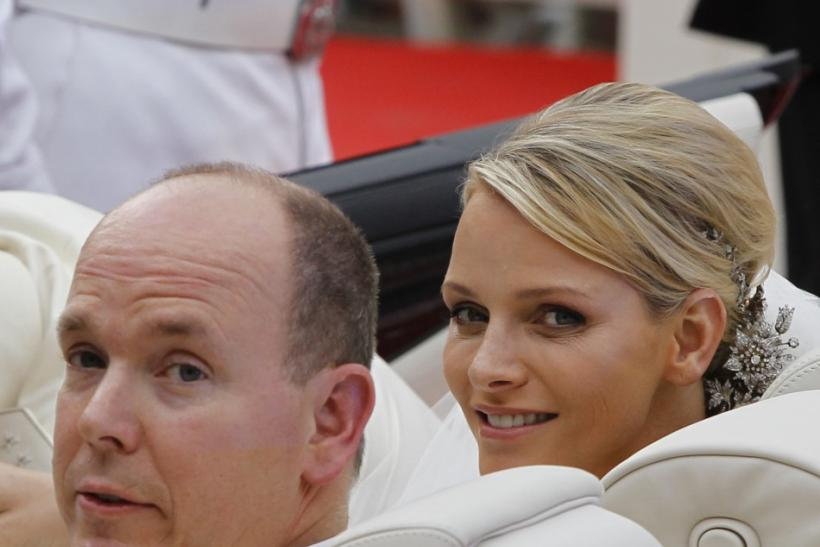 Prince Albert II of Monaco and Princess Charlene of Monaco depart in a car from the Monaco palace after their religious wedding ceremony in Monaco