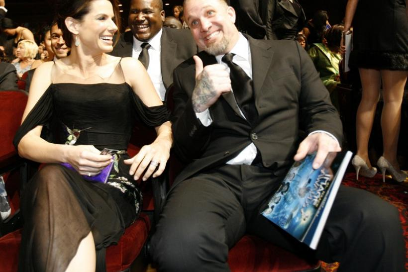 Jesse James gestures next to his wife actress Sandra Bullock