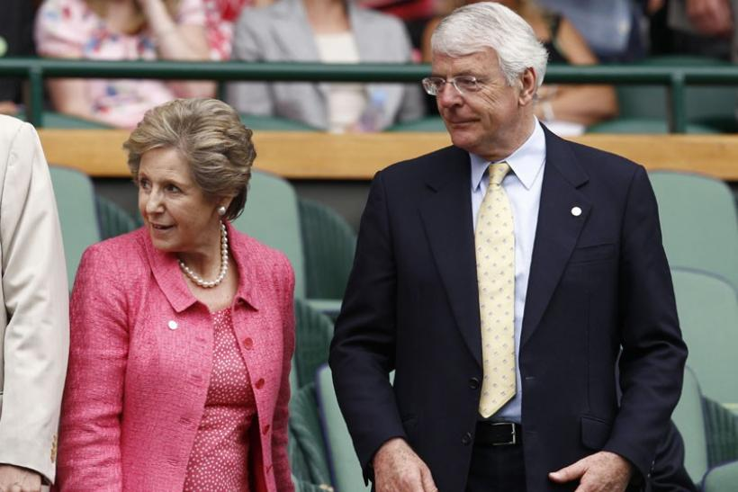 Former British Prime Minister John Major and his wife Norma arrive on Centre Court