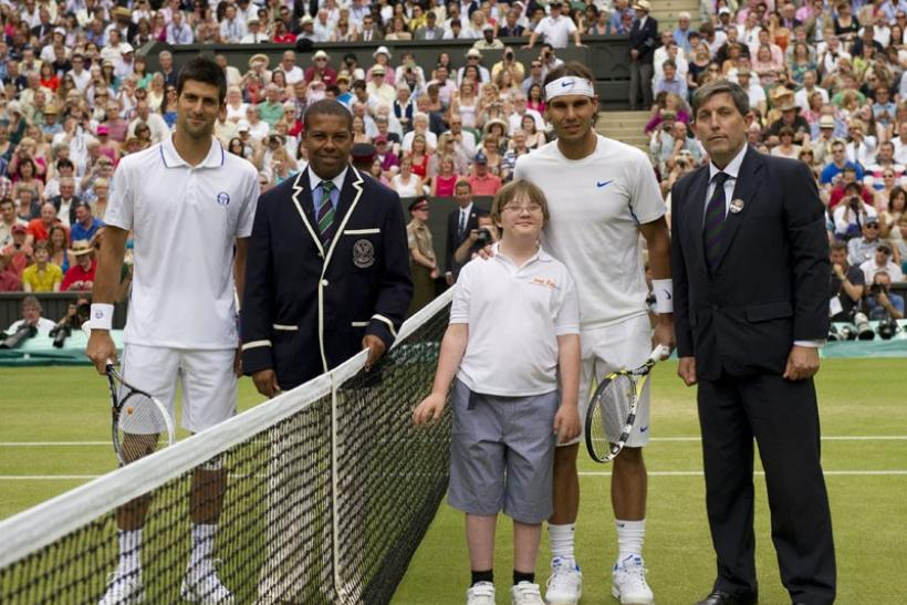 Rafael Nadal of Spain (2nd R) and Novak Djokovic of Serbia (L) pose for a photograph on Centre Court with officials