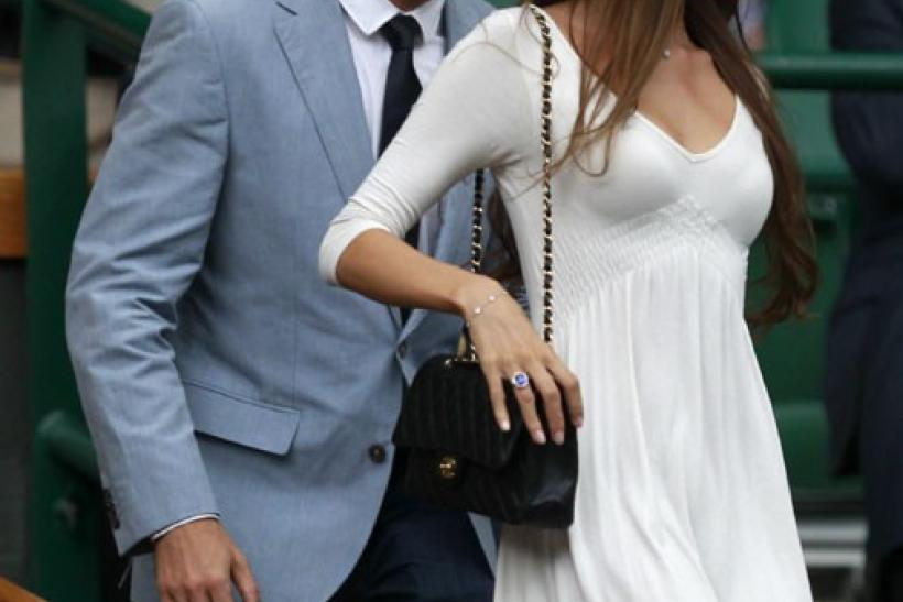 F1 driver Jenson Button and his girlfriend Jessica Michibata arrive on Centre Court