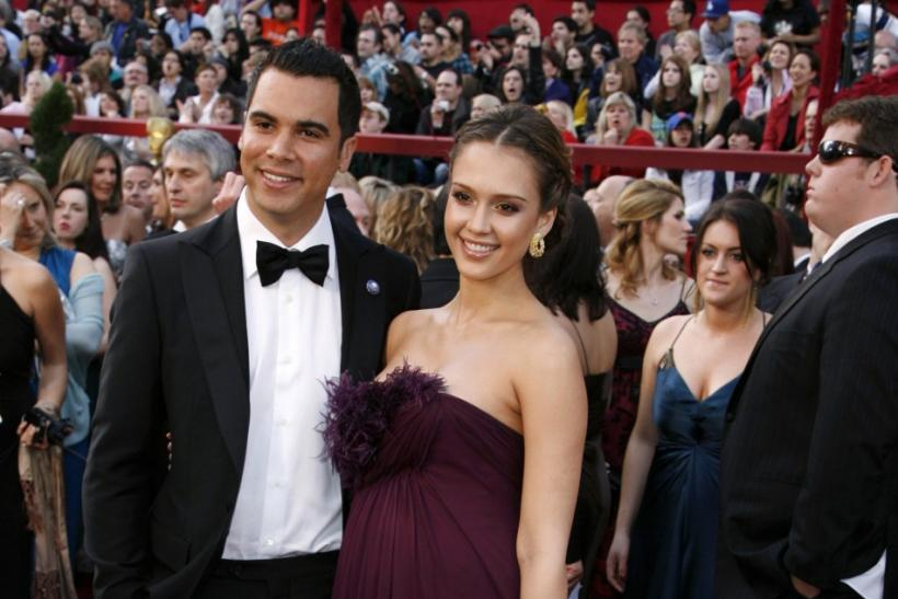 Actress Jessica Alba and her boyfriend Cash Warren arrive at the 80th annual Academy Awards in Hollywood