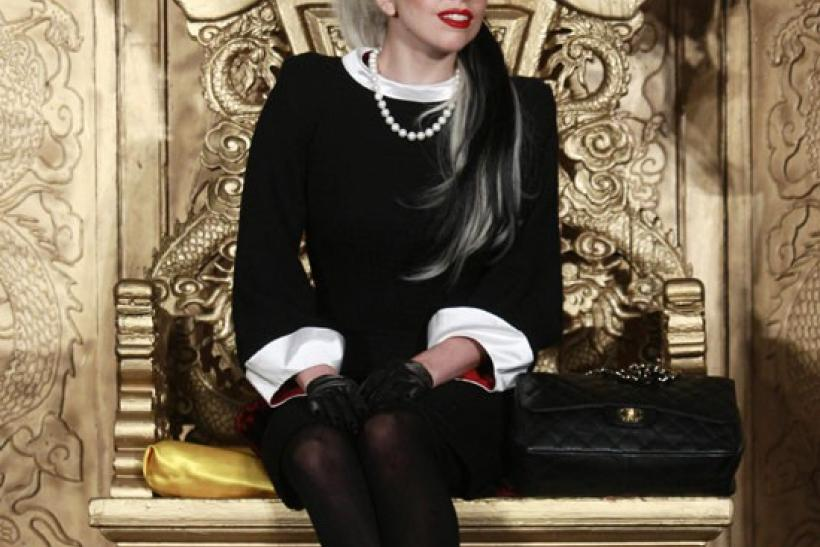 U.S. singer Lady Gaga listens to a question during a news conference