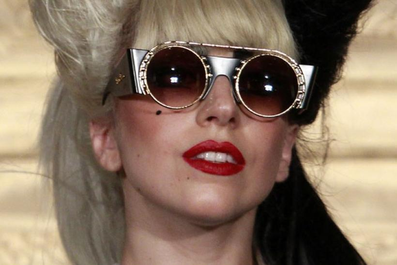 Lady Gaga listens to a question during a news conference in Taipei