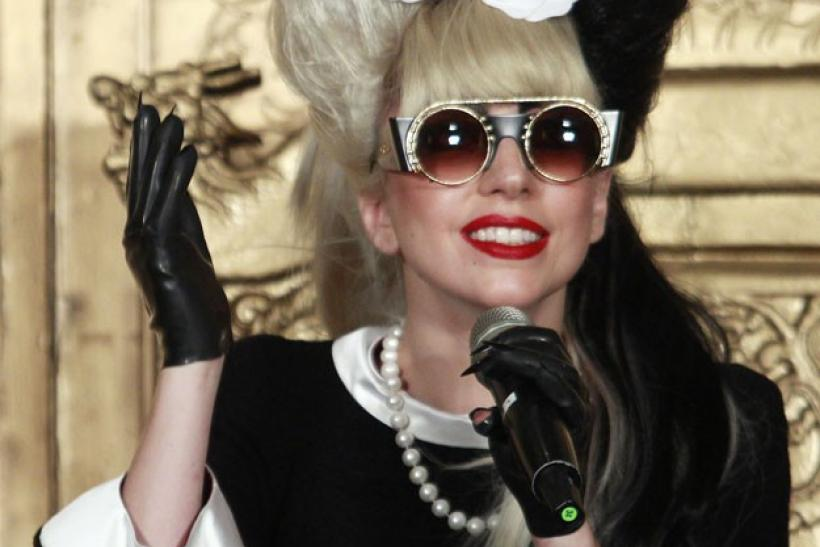 Lady Gaga speaks during the news conference in Taipei