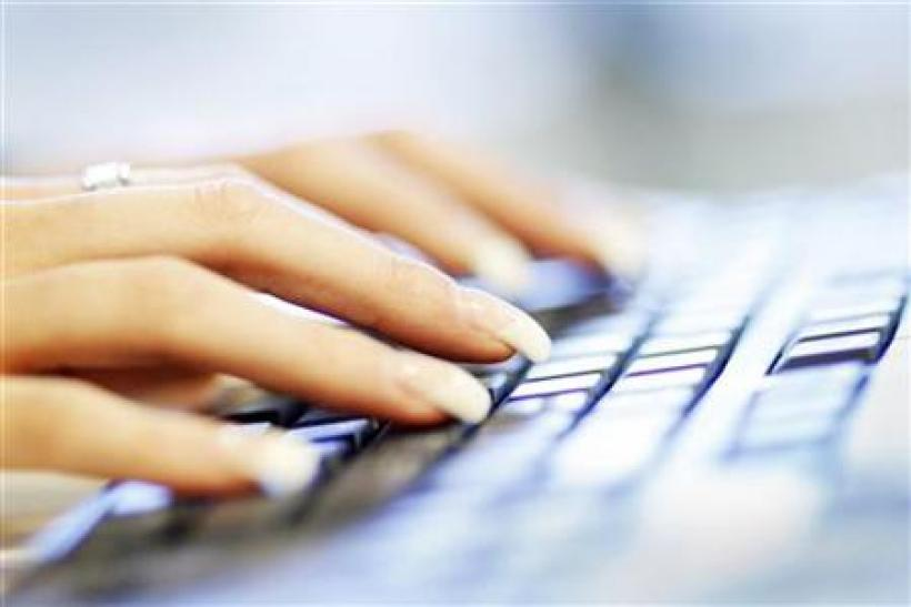 A woman uses a computer keyboard in this photo illustration taken in Sydney