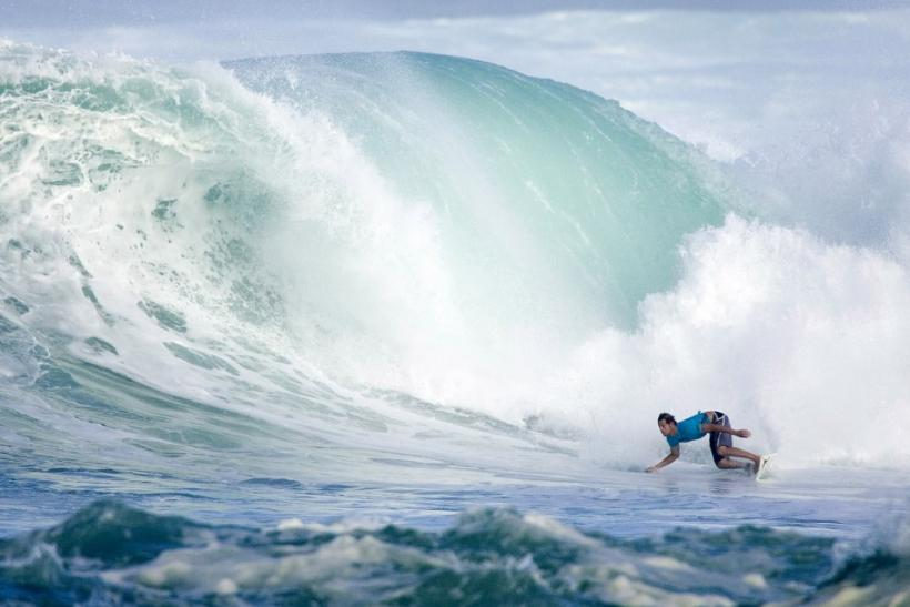 Richie Lovett of Australia surfs a wave