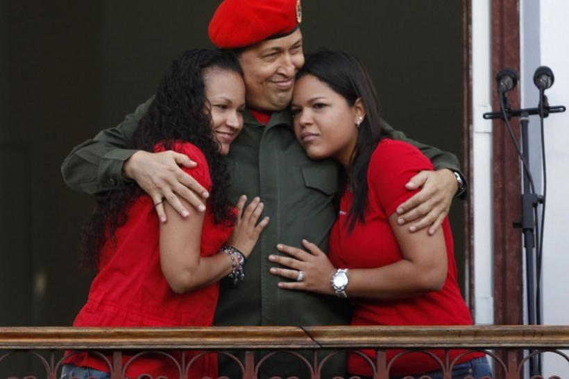Venezuela's President Hugo Chavez hugs his daughters in Caracas