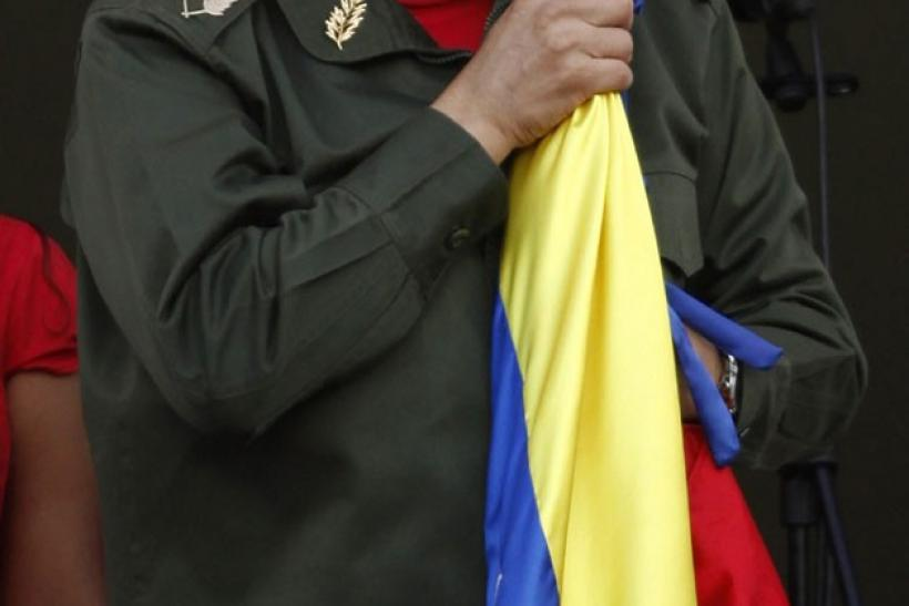 Venezuela's President Hugo Chavez kisses the national flag