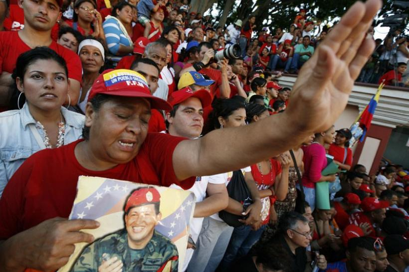 Supporters of Venezuela's President Hugo Chavez await his appearance in front of Miraflores Palace
