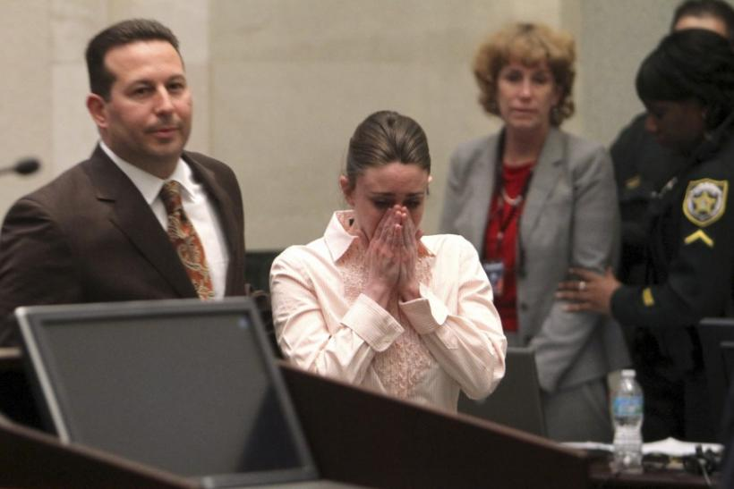 Casey Anthony approaches the podium to hear Judge Belvin Perry confirm that she is not guilty on first degree murder charges of her daughter Caylee at the Orange County Courthouse Orlando