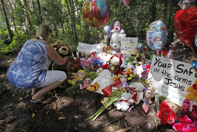 Marie Chalabi of Orlando places a toy bear at the wooded location of where the body of Caylee Anthony was found in 2008, in Orlando