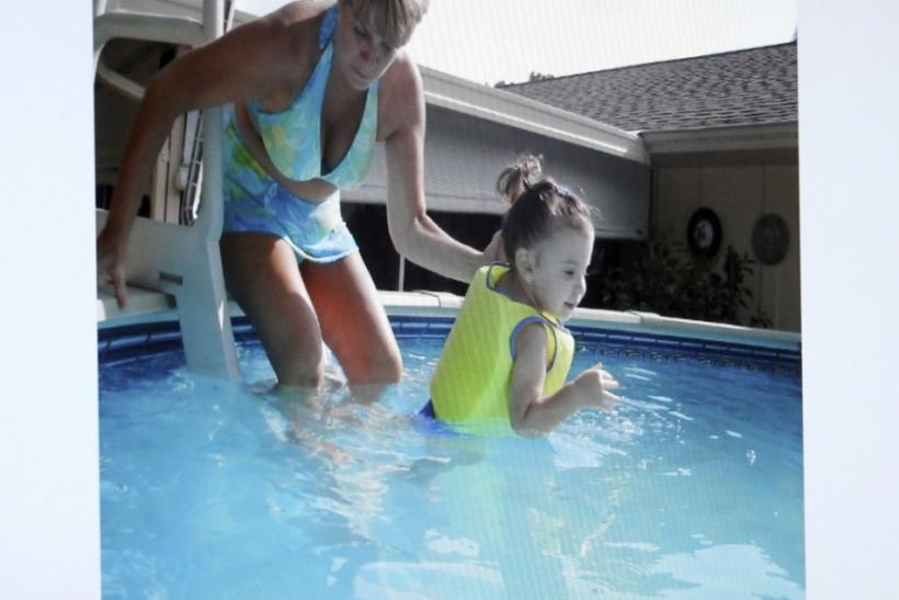 An image projected on a courtroom monitor shows Cindy Anthony with her granddaughter Caylee in a swimming pool in Orlando