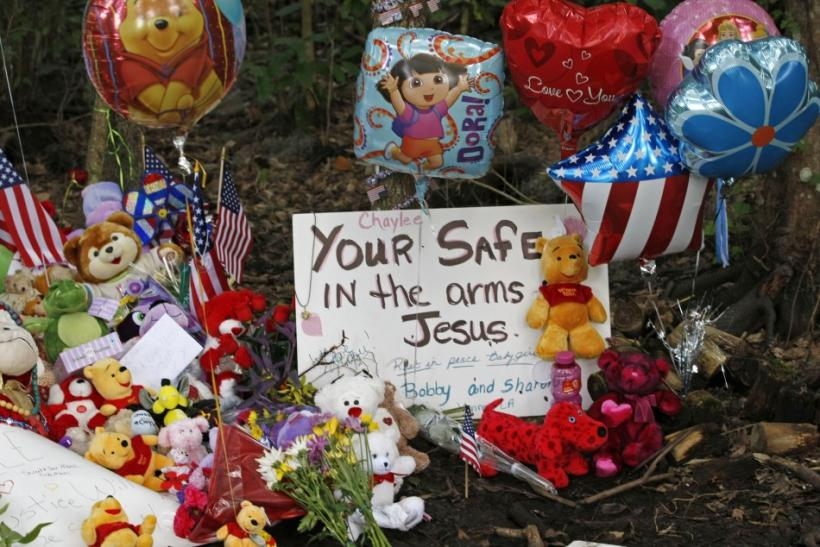 Balloons and toy teddy bears sit at the wooded location of where the body of Caylee Anthony was found in 2008
