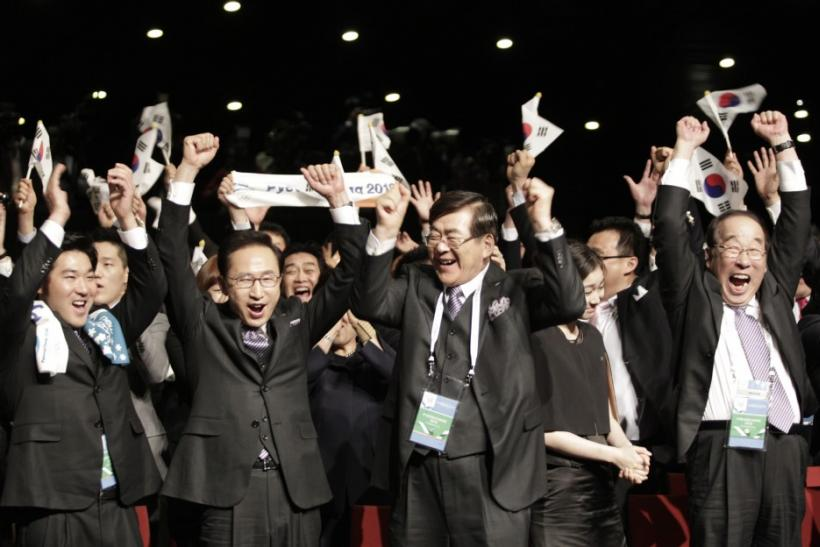 Members of Pyeongchang 2018 bid committee react after announcement of winning city bid for 2018 Winter Olympic Games in Durban