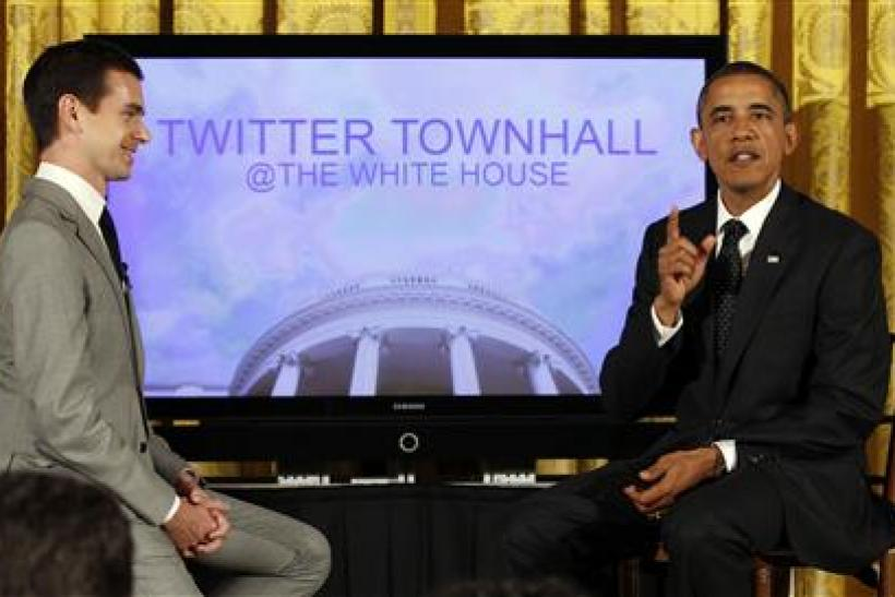 Obama talks to the audience next to Jack Dorsey during his first ever Twitter Town Hall in the East Room at the White House in Washington