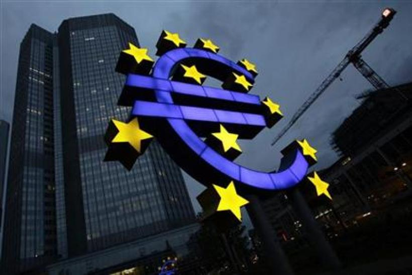 The illuminated euro sign is seen in front of the headquarters of the European Central Bank (ECB) in Frankfurt