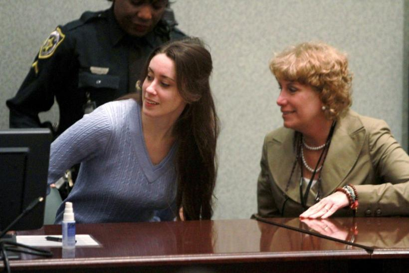 Casey Anthony (L) takes her seat next to her attorney Dorothy Clay Sims during her sentencing at the Orange County Courthouse in Orlando, Florida, July 7, 2011.