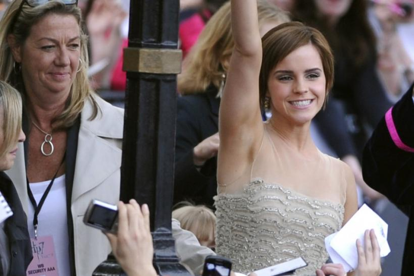 Emma Watson arrives at the world premiere of Harry Potter and The Deathly Hallows - Part 2 wearing Oscar de la Renta.