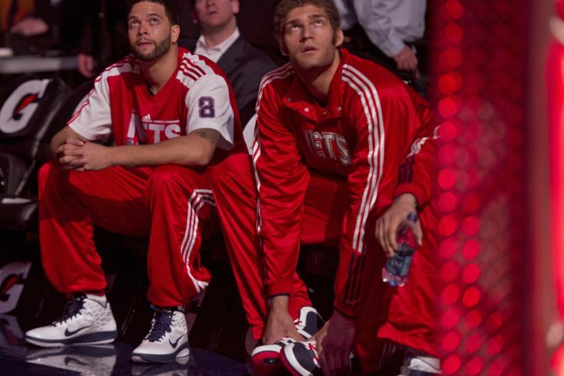New Jersey Nets guard Deron Williams and his new teammate center Brook Lopez wait during the introduction ceremony befor