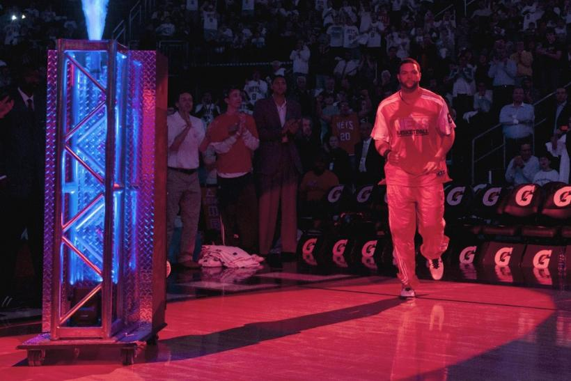 New Jersey Nets point guard Deron Williams is introduced to the crowd before the Nets played the Phoenix Suns in their N