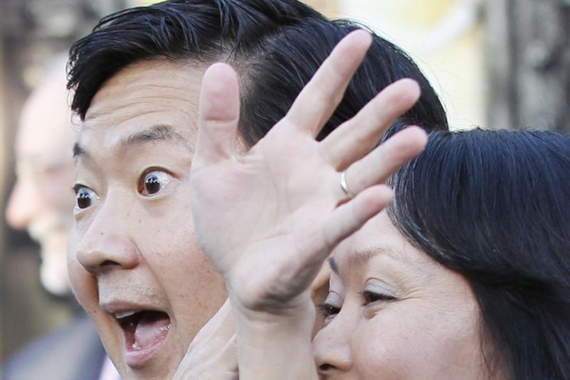 Cast member Ken Jeong (L) playfully blocks the face of his wife Tran Ho