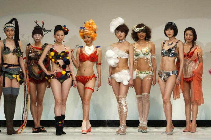 Models display lingerie designs in various themes as they pose at the Triumph Inspiration Award Japan lingerie design competition in Tokyo