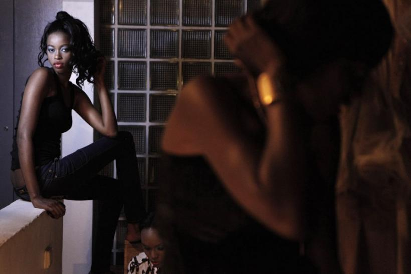 A Senegalese model sits backstage before the show