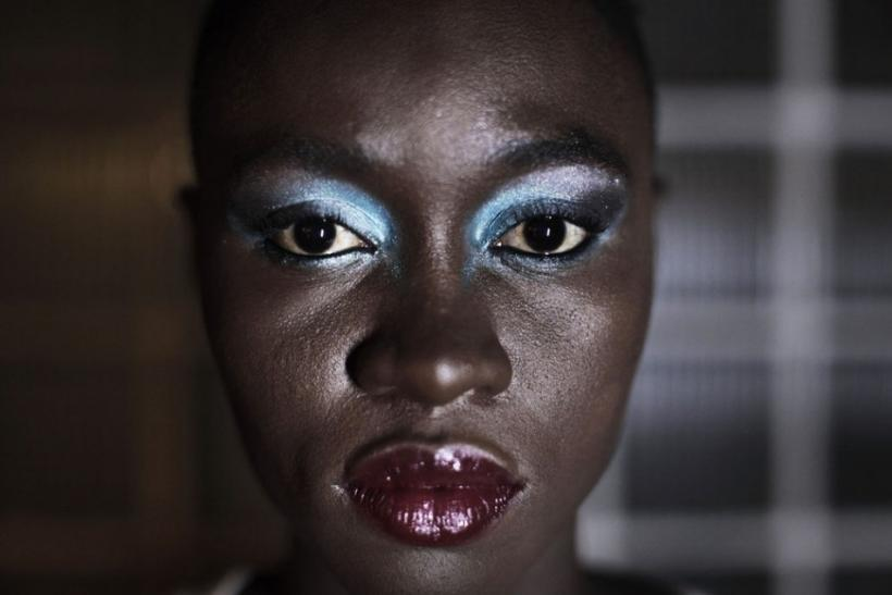 Senegalese model Sachakara Dieng applies make-up