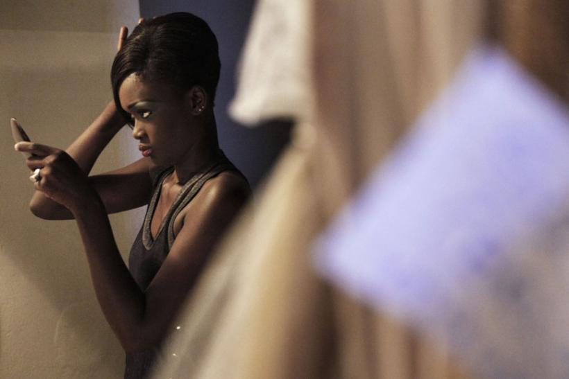 A Senegalese model checks her hair backstage