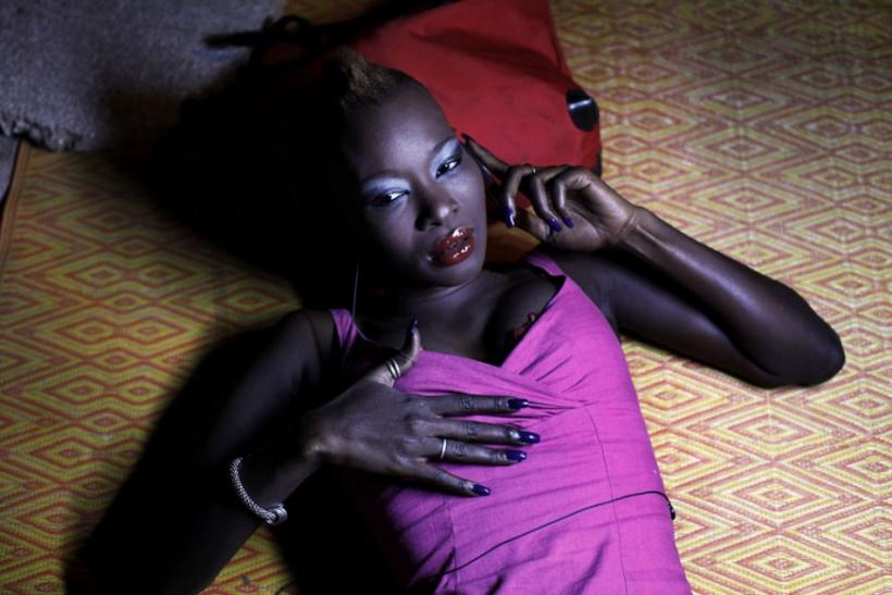 Model Fleur Mbaye uses her mobile phone backstage