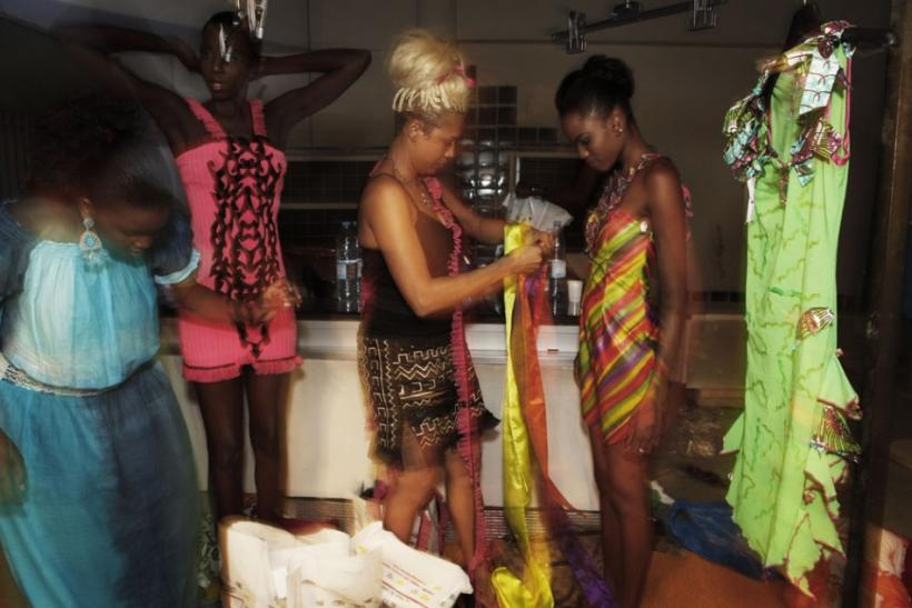 Ghanian designer Bee Arthur dresses a model backstage