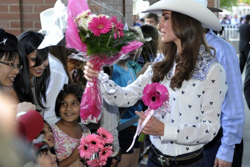 Catherine, Duchess of Cambridge, gets flowers from fans at the Calgary Stampede in Calgary.